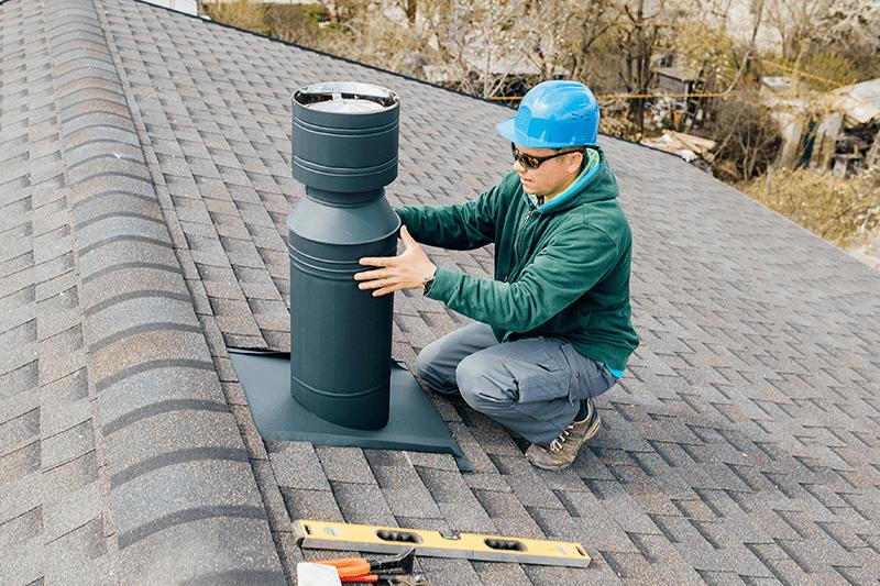 man working on chimney repair in NJ